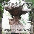 Oak & slate Garden Or Yard / Outside and Outdoor sculpture by sculptor Jon Evans titled: 'Ceridwen (Semi Natural CarvedTree trunk Wood Witch sculpture carving)' - Artwork View 1
