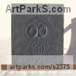 Hand carved Aberllefenni Slate (Welsh slate) Celtic Knot Work and Traditional sculpture by Jon Evans titled: 'Gwydion (Celtic Slate Carved Face Bas Relief sculpture)'