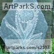 Hand carved Aberllefenni Slate (Welsh slate) Floral, Fruit and Plantlife sculpture by Jon Evans titled: 'Onion in Flower (Slate Bas Relief Carving)'