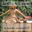 Recycled material Mythical sculpture by sculptor Karen Williams titled: 'Taki sitting Bronze effect faerie'