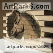 Books Books sculpture by Luke Boam titled: 'Metamorphosis Collection: The Trojan Horse carving statue'