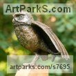 Bronze resin (cold cast bronze) and oak base Birds Sculptures or Statues sculpture by Marie Shepherd titled: 'Little Owl I (Stretching a Wing bronze Perched life size sculpture)'