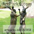 Iron resin Hares and Rabbits sculpture by sculptor Martin Duffy titled: 'Boxing Hares (Mad March Hares life size Boxing statue)'