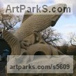 Sandstone Aquatic Sculptures Fish / Shells / Sharks / Seals / Corals / Seaweed sculpture by sculptor Martyn Bednarczuk titled: 'Salmon (Leaping Carved stone Outdoor garden/Yard sculpture)'