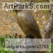 Bronze Wild Bird sculpture by sculptor Naomi Bunker titled: 'Merlin (Bronze Falcon Perched on Stump sculptures)'
