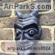Terra Cotta Mythical sculpture by sculptor Nicholas Webster titled: 'Terracotta Devil Mask (Wall Hung Face Black statue)'