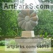 Ancaster Limestone Varietal cross section of Floral, Fruit and Plantlife sculpture by sculptor Nicolas Moreton titled: 'Flower (Carved Circular Outsize stone Daisy Flower Outdoors statue)'