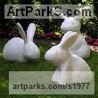 Resin sculpture by sculptor Paul Cox titled: 'Rabbits (Naive Primitive Happy Rabbits garden statues/statuettes/sculpture)'