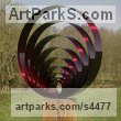Stainless Steel & oak Modern Abstract Contemporary Avant Garde Sculptures or Statues or statuettes or statuary sculpture by sculptor Thomas Joynes titled: 'Echoes (Concentric Circular stainless Steel garden/Yard sculptures)'